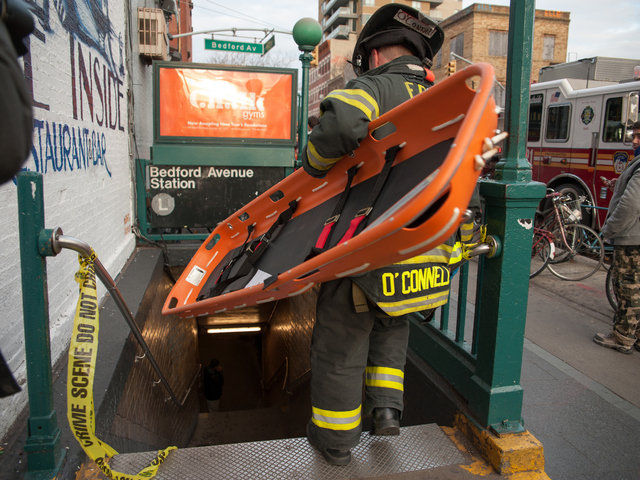 <p>Emergency responders on the scene at the Bedford Avenue stop for the L Train, where a woman was struck on Monday Jan. 21, 2013.</p>