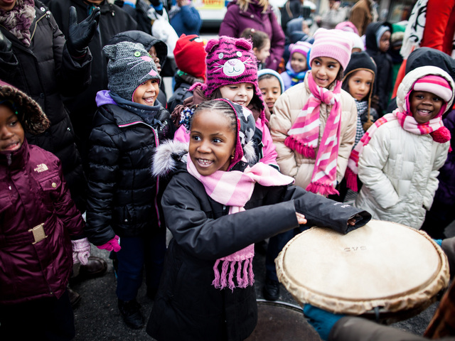 <p>A young girl enjoys the 36th Annual Three Kings Day Parade in East Harlem on Jan. 4, 2013.</p>