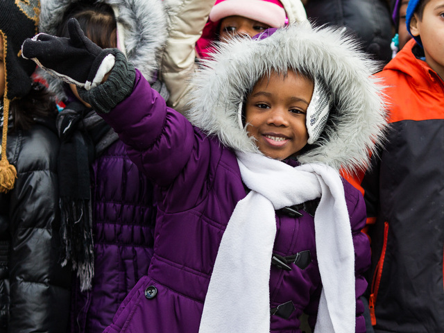 <p>A young girl enjoys the annual Three Kings Day Parade in Harlem on Jan. 4, 2013.</p>