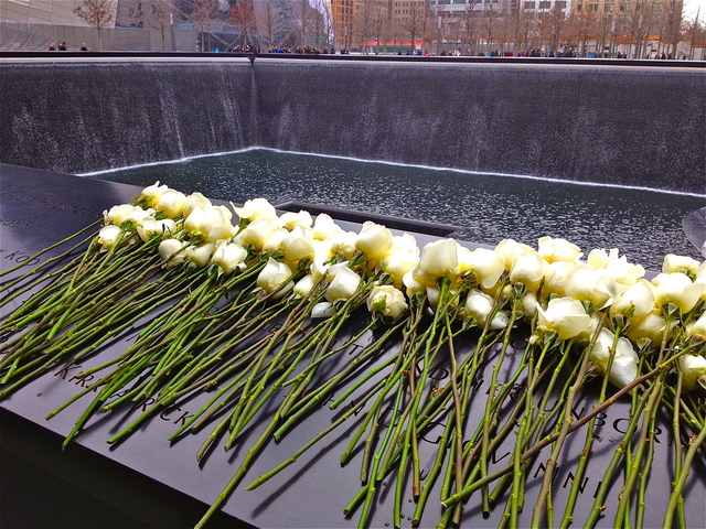 <p>White roses are left atop names of the six victims killed during the 1993 World Trade Center bombings. The 20th anniversary of the tragedy was commemorated at the 9/11 Memorial on February 26, 2013.</p>