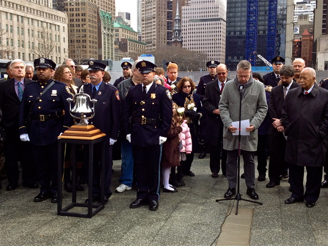 <p>William Macko, the son of a 1993 WTC bombing victim, reads names of those killed 20 years ago during a commemoration ceremony at the 9/11 memorial.</p>