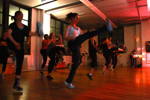 <p>Before each class, Sadie Kurzban, the instructor and founder of 305 Fitness, turns off the lights except for a disco ball, and signals the DJ.</p>
