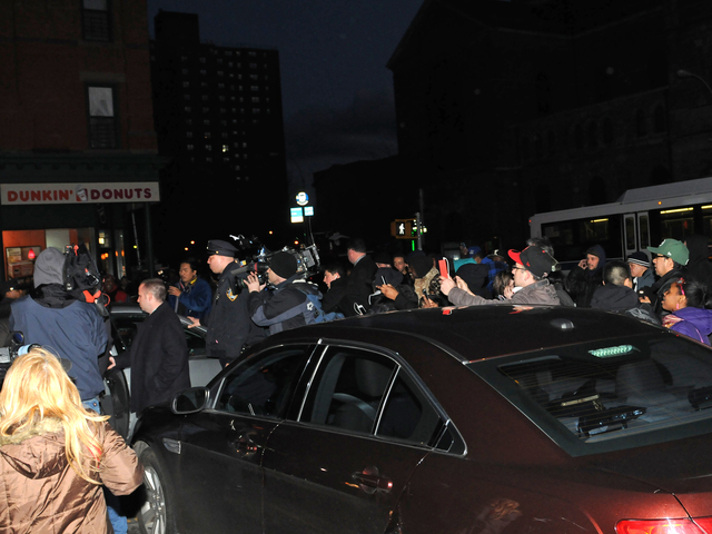 <p>The crowd outside the 40th Precinct in The Bronx surged toward the car where Bahsid McLean, 23, was taken by police after being charged with chopping up his mother&#39;s body.</p>