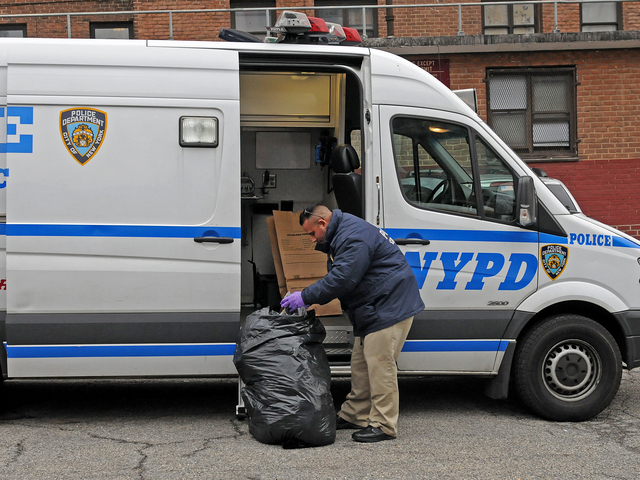 <p>Police examined a trash bag at 645 Westchester Ave. in The Bronx Feb. 26, 2013 after a woman&#39;s dismembered remains were found nearby.</p>