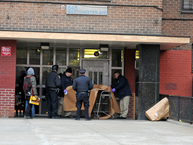 <p>Police wrapped up a shopping cart to remove it as possible evidence at 645 Westchester Ave. Feb. 26, 2013, after a woman&#39;s dismembered remains were found nearby.</p>