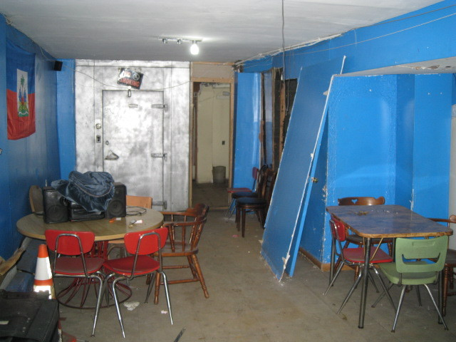 <p>Police say this basement in a Prospect-Lefferts Gardens grocery store acted as an illegal gambling den in July, taking horse-racing bets.</p>