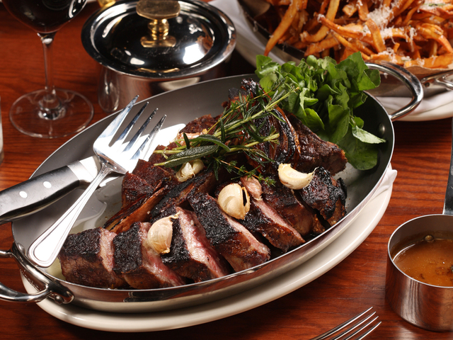<p>The Arlington Club is most known for serving steakhouse faves such as cote de boeuf and fries.</p>