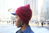 <p>Athanaelle Paul a fashion blogger, pairs a Brooklyn Dogers baseball cap with a University of Alabama beanie.</p>
