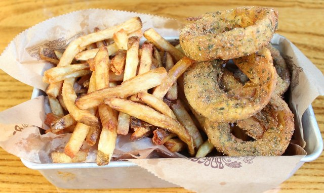 <p>The fries and onion ring combo at Bareburger.</p>