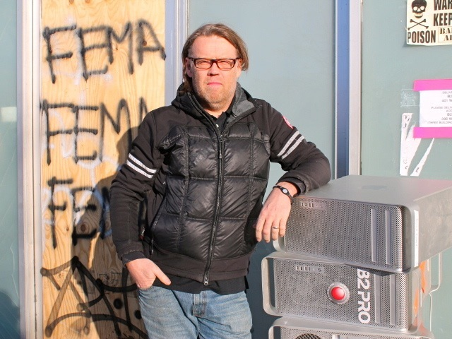 <p>Brent Langton, operator of the camera and lighting equipment company B2PRO, says he lost $10 million in gear during Hurricane Sandy. He stands in front of his former space at 401 West St. on Feb. 1, 2013, with computer towers that were destroyed during the storm.</p>