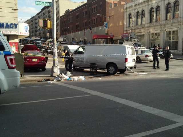 <p>A white van and a red Ford Focus crashed at Broadway and 135th Street Feb. 6, 2013.</p>
