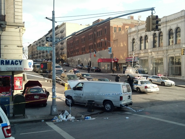<p>A two-car crash at Broadway and 135th Street sent the vehicles careening onto the sidewalk Feb. 6, 2013.</p>
