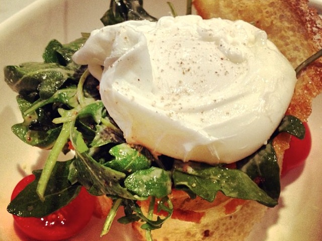 <p>A Caesar arugula salad with a poached egg is on the brunch menu at Murray&#39;s Cheese Bar.</p>