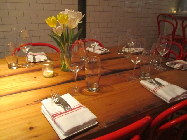 <p>Bright flowers topped the tables at Murray&#39;s Cheese Bar Feb. 19, 2013.</p>