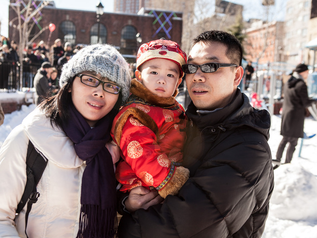 <p>(L-R) Cathy Li, 32, her son Benson, age 2, and husband Andy Chen, 33, enjoy the festivities at the Sara D. Roosevelt Park for the 14th Annual Firecracker Ceremony and Cultural Festival for the Chinese New Year on Feb. 10, 2013.</p>