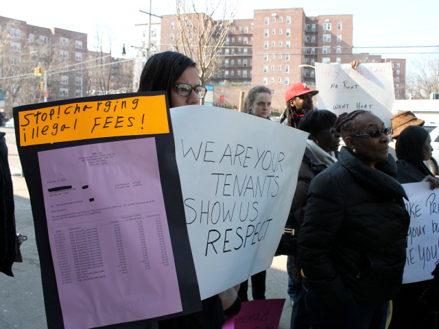 <p>Tenants protesting conditions in buildings run by Chestnut Holdings watch a nearby rally by the landlord&#39;s supporters.</p>