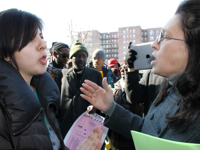 <p>Patricia Torres (left), an organizer with Community Action for Safe Apartments, debates with Althea Devivo, a Chestnut Holdings field manager. The two groups held competing rallies on Feb. 15, 2013.</p>