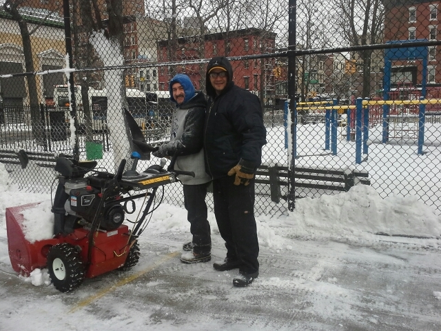 <p>Dil Collin and Israel Bonanno shoveling snow outside of ABC Playground, on the Lower East Side on Feb. 9, 2013.</p>
