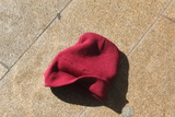 <p>A lost colored beanie on the ground at Lincoln Center at Fashion Week.</p>