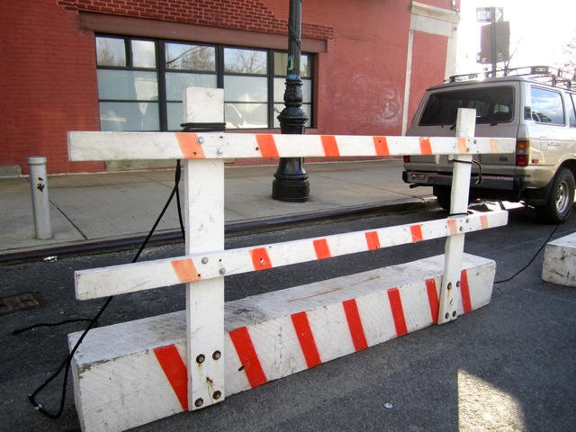 <p>Construction barriers like this one outside the 150 Charles St. condo development project struck 401 West St. and caused damage, according to a business tenant there.&nbsp;</p>