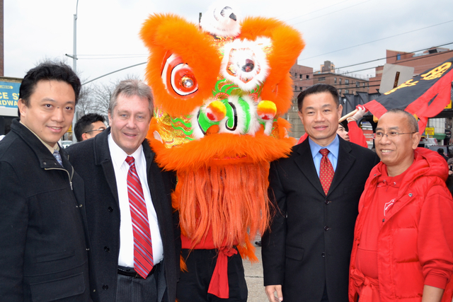 <p>Councilman Daniel Dromm and Comptroller John Liu flank a dragon dancer at the Elmhurst Lunar New Year Festival. This year&#39;s festival features a parade.</p>