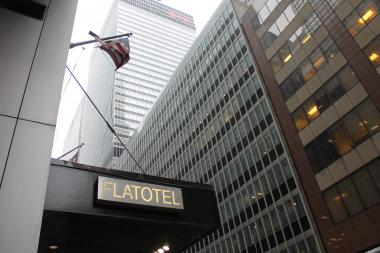The investment duo slated to buy the Sony building in Midtown for $1.1 billion purchased a shuttered luxury hotel in Midtown earlier this month, a 46-story property they reportedly plan to convert to high-end condos.   Investors Joseph Chetrit and David Bistricer bought the Flatotel, on West 52nd Street near Seventh Avenue, for about $180 million in early February, according to a report by Crain's. The hotel, which housed 289 rooms and Moda Restaurant, was foreclosed upon by three investment groups after the building's owner, the Alexico Group, defaulted on debts against the property.
