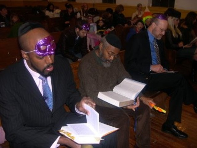 <p>Local Jews celebrate Purim at Congregation Kol Israel near the intersection of Franklin Avenue and St. Johns Place</p>