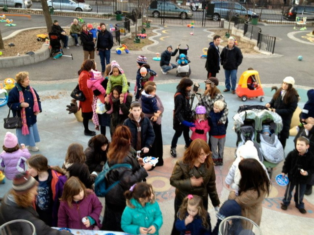 <p>A Hanukkah menorah lighting in Underhill Playground</p>