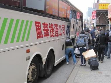 Passengers board a Fung Wah bus in Chinatown.