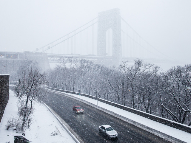 <p>The George Washington Bridge in Washington Heights is shrouded in mist as a massive snowstorm hits New York City on Feb. 8, 2013.</p>