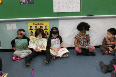 Pre-K students at East Harlem's Central Park East II read while preparing to go to dance class.