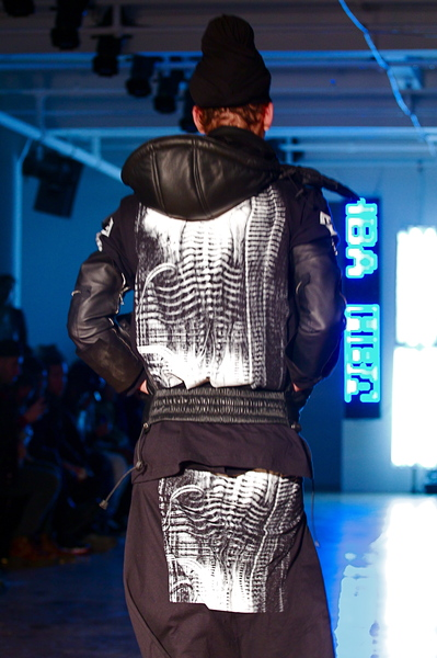 <p>Printing on the back of a leather puffer vast and matching graphic t-shirt</p>