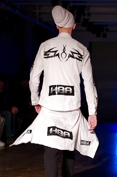 <p>Back details of white cotton look and shirt tied around the waist echoing graphics</p>