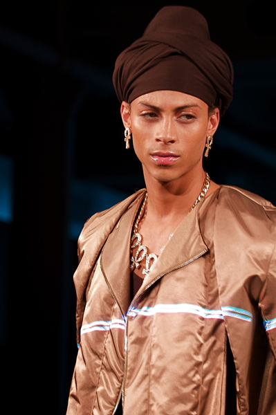 <p>Bronze shiny nylon jacket and eye catching brown turban</p>