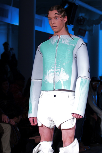 <p>Green and light grey neoprene jacket and transformative pants</p>