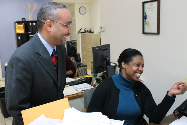 <p>State Sen. Jose Peralta&nbsp;laughs with a staffer in his East Elmhurst district office.</p>