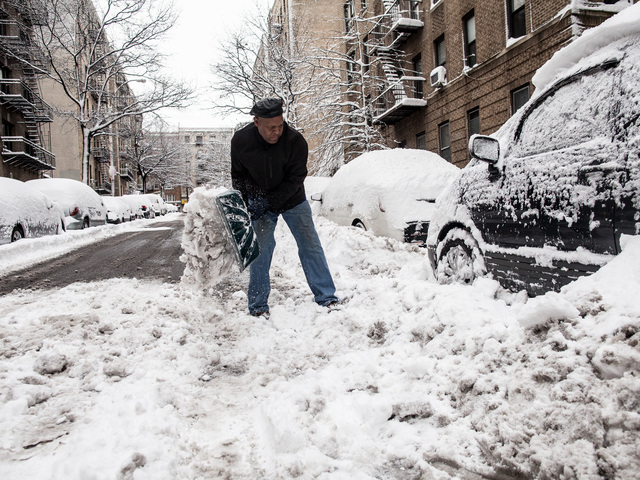 <p>Marcos Herbert, 51, digs out the snow from his Toyota Previa on Bennett Ave., in Washington Heights on Feb. 9, 2013.</p>