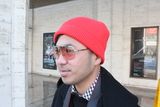 <p>Mark Pagaduan, a photographer for Lacoste, wears a beanie from the fashion house he works for.</p>
