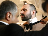 <p>Brett David, Maitre D&#39; of THE GENERAL, gets ready for the Michael Fenici runway show. &quot;I&#39;m getting a kick out of this,&quot; David said. &quot;I just have to remember to turn left.&quot;</p>