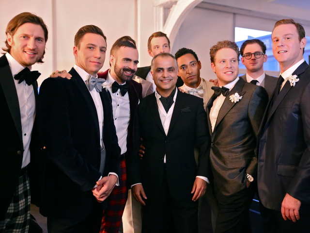 <p>Designer Michael Fenici with his &quot;real men&quot; models. &quot;We chose business men because they are real,&quot; Fenici said. &quot;This is who I actually design for.&quot;</p>