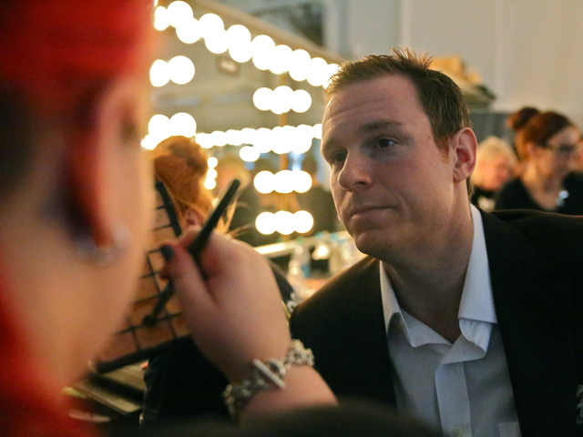 <p>Joshua Kaston, Vice President of Financial Alliance Processing Services, has his makeup done before the Michael Fenici runway show. &quot;I am 6&#39;2 and 220-lbs,&quot; Kaston said. &quot; I am not a traditional model size.&quot;</p>
