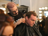 <p>Joshua Kaston, Vice President of Financial Alliance Processing Services, sits in the hair stylist&#39;s chair before the Michael Fenici runway show. &quot;Michael Fenici&#39;s clothes are like artwork,&quot; Kaston said. &quot;They are a second skin.&quot;</p>