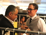 <p>Jonathan Stein, co-founder of VNV Media, talks with designer&nbsp; Michael Fenici before the show.</p>