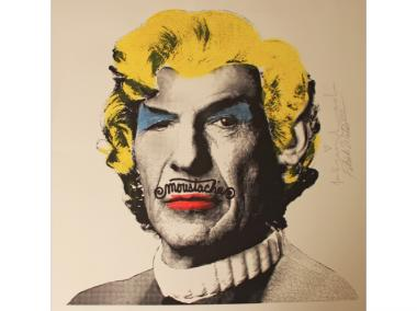 "Patrick Waldo tags advertising posters with ""moustache"" scrawled across a muse's upper lip."