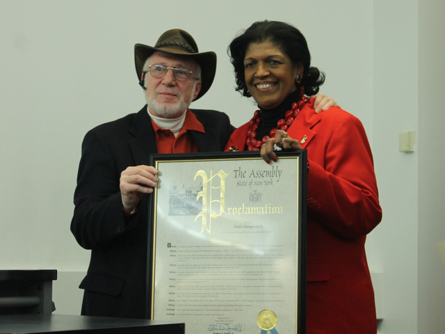 <p>Pamela-Palanque North is honored with a proclamation from Assemblyman Denny Farrell, delivered by assistant Frank Hess.</p>