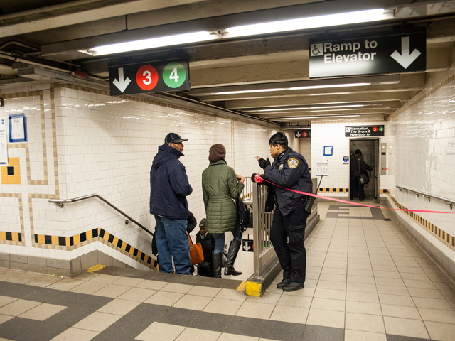 <p>A police officer directs passengers to the platforms still in operation on Tuesday February 12th, 2013.</p>