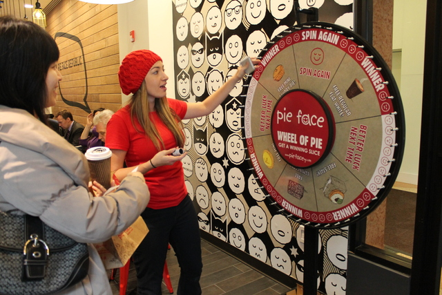 <p>Pie Face brand manager Tennille Scicluna invites a customer to spin a wheel for free prizes Tuesday, Feb. 19, 2013. The giveaway was part of an event celebrating the opening of Pie Face&#39;s third Manhattan location on Seventh Avenue.</p>