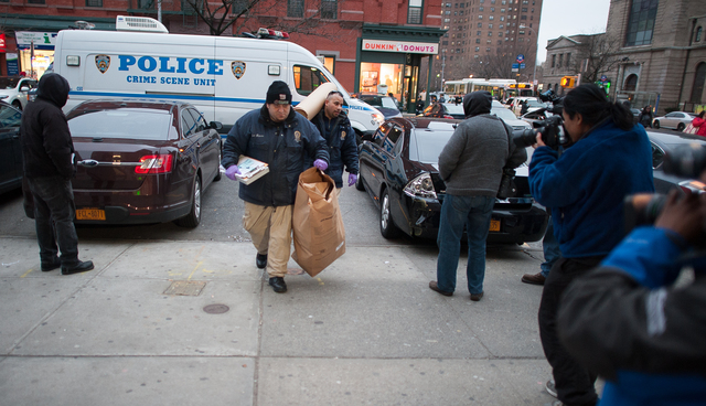 <p>The NYPD brought evidence to the 40th Precinct stationhouse Feb. 26, 2013.</p>