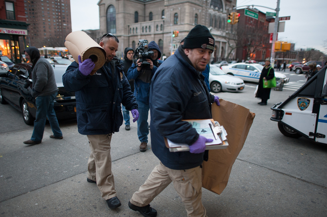 <p>NYPD officers arrived at the 40th Precinct stationhouse Feb. 26, 2013.</p>