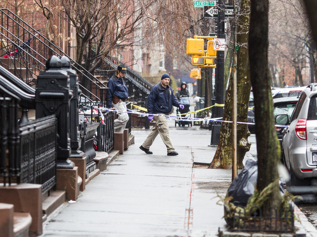 <p>Police investigate 388 Clinton St. in Brooklyn after Elizabeth Borst was found with a head wound and later died on Feb. 23, 2013.</p>